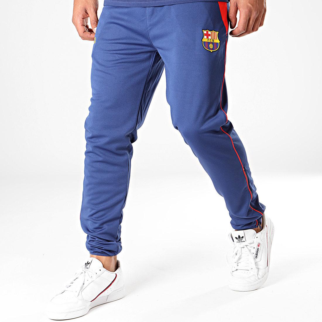 Pantalon de jogging avec coupe ajust/ée gar/çon th/ème football//motif blason//polaire 10-11 ans FC Barcelona officiel