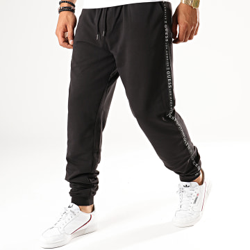 Guess - Pantalon Jogging A Bandes M94B42-K7ON0 Noir Blanc