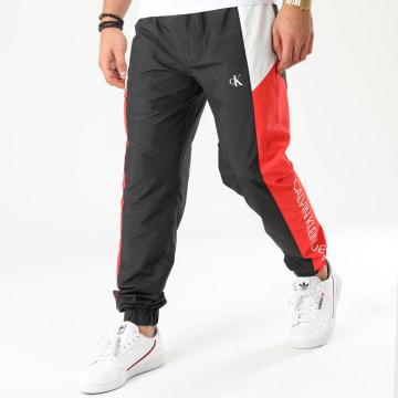 Calvin Klein - Pantalon Jogging Tricolore Color Block Nylon 4942 Noir Rouge Blanc