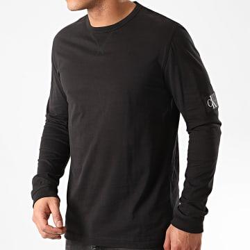 Calvin Klein - Tee Shirt Manches Longues Badge Sleeve 5108 Noir
