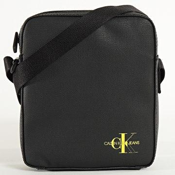 Calvin Klein - Sacoche Micro Flat 5554 Noir