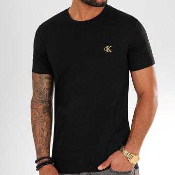 Calvin Klein - Tee Shirt Essential Broderie Gold 7318 Noir Doré