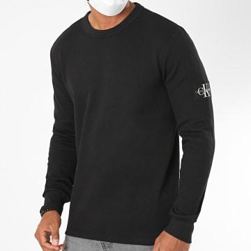 Calvin Klein - Tee Shirt Manches Longues Monogram Badge 5607 Noir