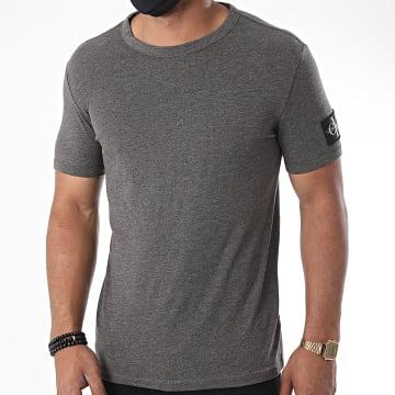 Calvin Klein - Tee Shirt Monogram Badge Grind 5611 Gris Chiné