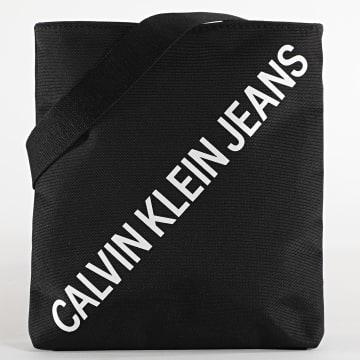 Calvin Klein - Sacoche Micro Flat Pack 6440 Noir