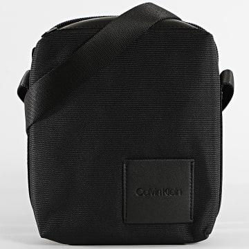 Calvin Klein - Sacoche Split Mini Reporter 4617 Noir