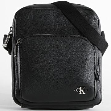 Calvin Klein - Sacoche Mini Reporter 6384 Noir