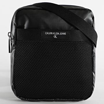 Calvin Klein - Sacoche Mini Reporter 6641 Noir