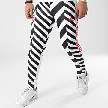 Adidas Performance - Pantalon Jogging A Bandes Manchester United FC AOP GK9435 Blanc Noir