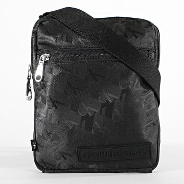 Calvin Klein - Sacoche Micro Reporter 6472 Noir