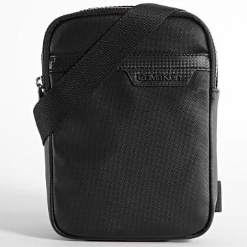 Calvin Klein - Sacoche Conv Reporter 7504 Noir