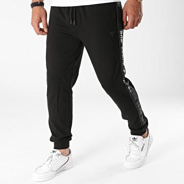 Guess - Pantalon Jogging A Bandes U1GA11-K6ZS1 Noir