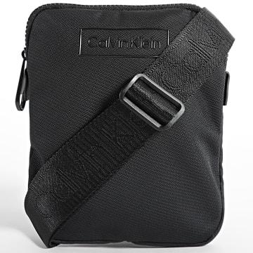 Calvin Klein - Sacoche Code Flatpack 7320 Noir