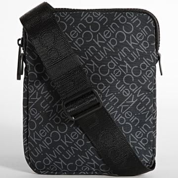 Calvin Klein - Sacoche Code Flatpack 8094 Noir