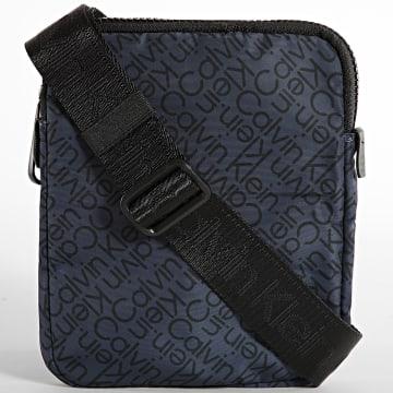 Calvin Klein - Sacoche Code Flatpack 8094 Bleu Marine