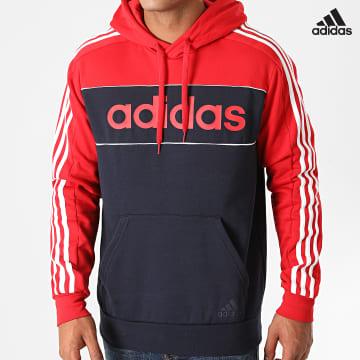 https://laboutiqueofficielle-res.cloudinary.com/image/upload/v1627638668/Desc/Watermark/adidas_performance.svg Adidas Performance - Sweat Capuche A Bandes GL7465 Bleu Marine Rouge