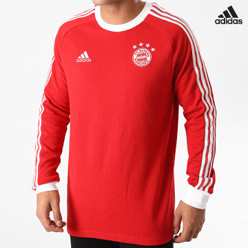 https://laboutiqueofficielle-res.cloudinary.com/image/upload/v1627638668/Desc/Watermark/adidas_performance.svg Adidas Performance - Tee Shirt Manches Longues A Bandes FC Bayern Munich Icons GM3994 Rouge