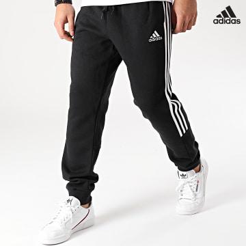 https://laboutiqueofficielle-res.cloudinary.com/image/upload/v1627638668/Desc/Watermark/adidas_performance.svg Adidas Performance - Pantalon Jogging A Bandes GK8967 Noir