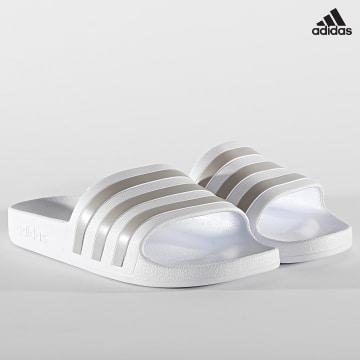 https://laboutiqueofficielle-res.cloudinary.com/image/upload/v1627638668/Desc/Watermark/adidas_performance.svg Adidas Performance - Claquettes Femme Adilette Aqua EF1730 Cloud White Platinum Metallic