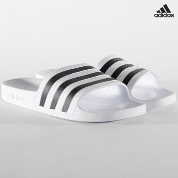 https://laboutiqueofficielle-res.cloudinary.com/image/upload/v1627638668/Desc/Watermark/adidas_performance.svg Adidas Performance - Claquettes Adilette Aqua F35539 Footwear White Core Black
