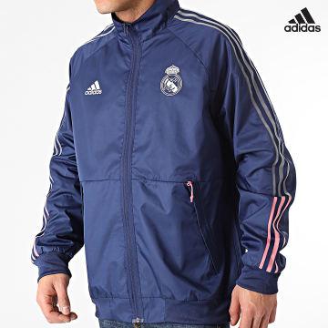 https://laboutiqueofficielle-res.cloudinary.com/image/upload/v1627638668/Desc/Watermark/adidas_performance.svg Adidas Performance - Veste Zippée A Bandes Real Madrid Anthem FR3880 Bleu Marine