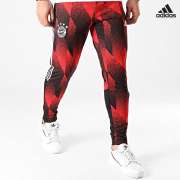 https://laboutiqueofficielle-res.cloudinary.com/image/upload/v1627638668/Desc/Watermark/adidas_performance.svg Adidas Performance - Pantalon Jogging A Bandes FC Bayern AOP GK8624 Rouge Noir