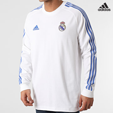 https://laboutiqueofficielle-res.cloudinary.com/image/upload/v1627638668/Desc/Watermark/adidas_performance.svg Adidas Performance - Tee Shirt Manches Longues A Bandes Real Madrid Icons GI0007 Blanc