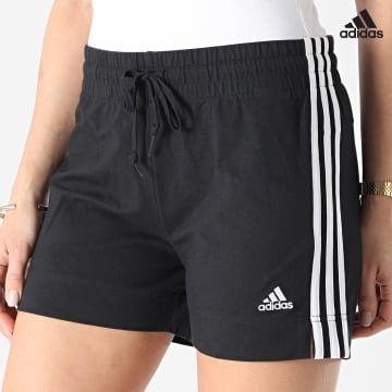 https://laboutiqueofficielle-res.cloudinary.com/image/upload/v1627638668/Desc/Watermark/adidas_performance.svg Adidas Performance - Short Jogging Femme A Bandes GM5523 Noir