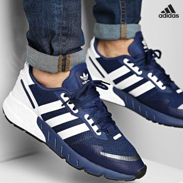https://laboutiqueofficielle-res.cloudinary.com/image/upload/v1627638668/Desc/Watermark/adidas_performance.svg Adidas Performance - Baskets ZX 1K Boost H68719 Dark Blue Footwear White Core Black