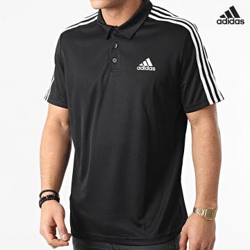 https://laboutiqueofficielle-res.cloudinary.com/image/upload/v1627638668/Desc/Watermark/adidas_performance.svg Adidas Performance - Polo Manches Courtes A Bandes 3 Stripes GM2075 Noir