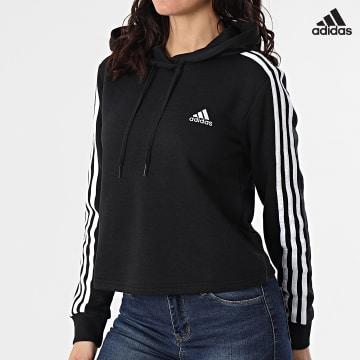 https://laboutiqueofficielle-res.cloudinary.com/image/upload/v1627638668/Desc/Watermark/adidas_performance.svg Adidas Performance - Sweat Capuche Crop Femme A Bandes GM5582 Noir