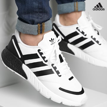 https://laboutiqueofficielle-res.cloudinary.com/image/upload/v1627638668/Desc/Watermark/adidas_performance.svg Adidas Performance - Baskets ZX 1K Boost FX6510 Cloud White Core Black Halo Silver