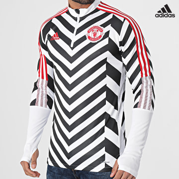 https://laboutiqueofficielle-res.cloudinary.com/image/upload/v1627638668/Desc/Watermark/adidas_performance.svg Adidas Performance - Sweat Col Zippé A Bandes Manchester United AOP GK9413 Blanc Noir