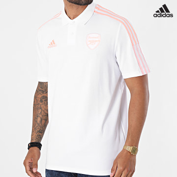 https://laboutiqueofficielle-res.cloudinary.com/image/upload/v1627638668/Desc/Watermark/adidas_performance.svg Adidas Performance - Polo Manches Courtes A Bandes Arsenal FC GK9396 Ecru