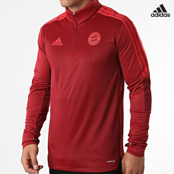 https://laboutiqueofficielle-res.cloudinary.com/image/upload/v1627638668/Desc/Watermark/adidas_performance.svg Adidas Performance - Tee Shirt Manches Longues A Bandes FC Bayern GR0672 Bordeaux