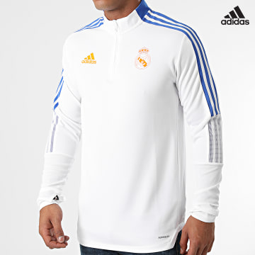 https://laboutiqueofficielle-res.cloudinary.com/image/upload/v1627638668/Desc/Watermark/adidas_performance.svg Adidas Performance - Tee Shirt Manches Longues A Bandes Real Madrid GR4328 Ecru