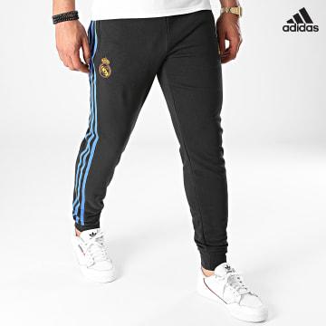 https://laboutiqueofficielle-res.cloudinary.com/image/upload/v1627638668/Desc/Watermark/adidas_performance.svg Adidas Performance - Pantalon Jogging A Bandes Real Madrid GR4308 Noir