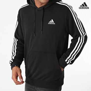 https://laboutiqueofficielle-res.cloudinary.com/image/upload/v1627638668/Desc/Watermark/adidas_performance.svg Adidas Performance - Sweat Capuche A Bandes GK9062 Noir