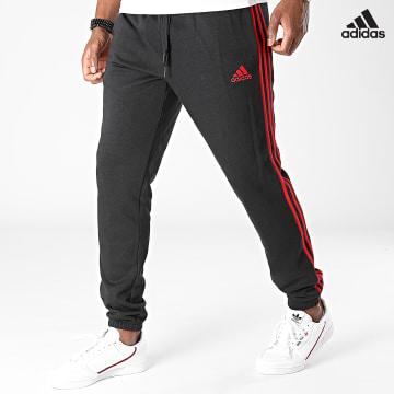 https://laboutiqueofficielle-res.cloudinary.com/image/upload/v1627638668/Desc/Watermark/adidas_performance.svg Adidas Performance - Pantalon Jogging A Bandes H12254 Noir Rouge
