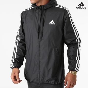 https://laboutiqueofficielle-res.cloudinary.com/image/upload/v1627638668/Desc/Watermark/adidas_performance.svg Adidas Performance - Coupe-Vent A Bandes GK9026 Noir