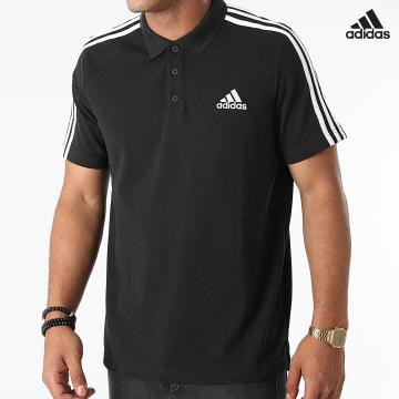https://laboutiqueofficielle-res.cloudinary.com/image/upload/v1627638668/Desc/Watermark/adidas_performance.svg Adidas Performance - Polo Manches Courtes A Bandes GK9097 Noir