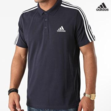 https://laboutiqueofficielle-res.cloudinary.com/image/upload/v1627638668/Desc/Watermark/adidas_performance.svg Adidas Performance - Polo Manches Courtes A Bandes GK9100 Bleu Marine