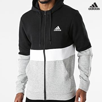https://laboutiqueofficielle-res.cloudinary.com/image/upload/v1627638668/Desc/Watermark/adidas_performance.svg Adidas Performance - Sweat Zippé Capuche A Bandes CB GV5244 Gris Chiné Noir