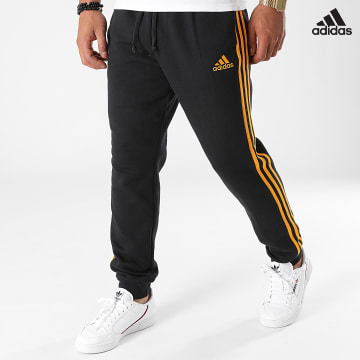 https://laboutiqueofficielle-res.cloudinary.com/image/upload/v1627638668/Desc/Watermark/adidas_performance.svg Adidas Performance - Pantalon Jogging A Bandes H12260 Noir Orange