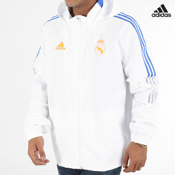 https://laboutiqueofficielle-res.cloudinary.com/image/upload/v1627638668/Desc/Watermark/adidas_performance.svg Adidas Performance - Veste Zippée Capuche A Bandes Real Madrid GR4338 Ecru