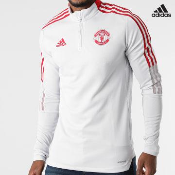 https://laboutiqueofficielle-res.cloudinary.com/image/upload/v1627638668/Desc/Watermark/adidas_performance.svg Adidas Performance - Tee Shirt De Sport Manches Longues A Bandes Manchester United GR3812 Gris Clair