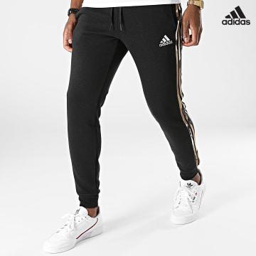 https://laboutiqueofficielle-res.cloudinary.com/image/upload/v1627638668/Desc/Watermark/adidas_performance.svg Adidas Performance - Pantalon Jogging A Bandes Camouflage GV2125 Noir