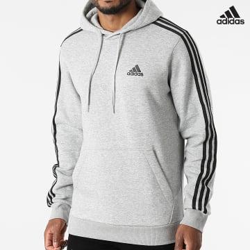 https://laboutiqueofficielle-res.cloudinary.com/image/upload/v1627638668/Desc/Watermark/adidas_performance.svg Adidas Performance - Sweat Capuche A Bandes 3 Stripes GK9084 Gris Chiné