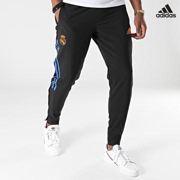 https://laboutiqueofficielle-res.cloudinary.com/image/upload/v1627638668/Desc/Watermark/adidas_performance.svg Adidas Performance - Pantalon Jogging A Bandes Real Madrid GR4321 Noir