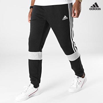 https://laboutiqueofficielle-res.cloudinary.com/image/upload/v1627638668/Desc/Watermark/adidas_performance.svg Adidas Performance - Pantalon Jogging A Bandes Essentials Colorblock GV5245 Noir